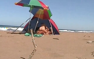 Greek beach sex - hot couple gets fucked in a tent