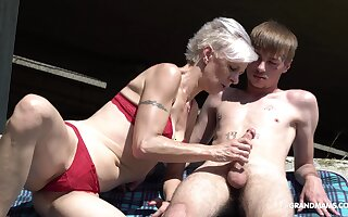 Kinky granny thither thongs sucks a beamy hard penis of one young guy