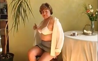 Older lady masturbating on a chair with dildo and reach a great orgasm